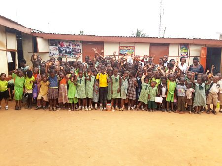 A cross section of students of Street to School Initiative with IA team